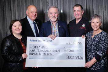 Cookstown Black Santa charity cheques